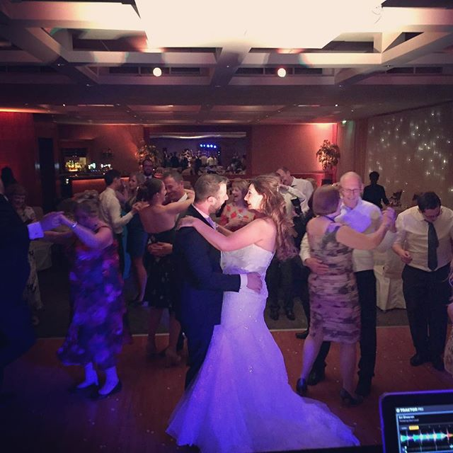 Wedding DJ has full Dance Floor with Bride and Groom in the middle